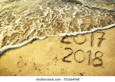 New Year concept written on sand