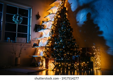 new year cozy home interior with christmas tree and garlands