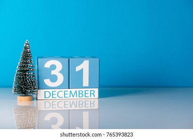 New year. December 31st. Day 31 of december month, calendar with little christmas tree on blue background. Winter time. Empty space for text. New year concept