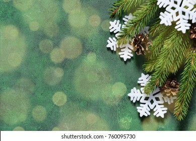 New Year decoration with bokeh effect on a green background. Merry Christmas and Happy New Year!