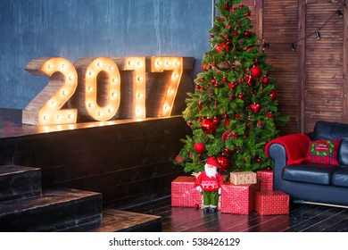 new year decoration closeup on 2017 beautiful christmas interior with green leather chair