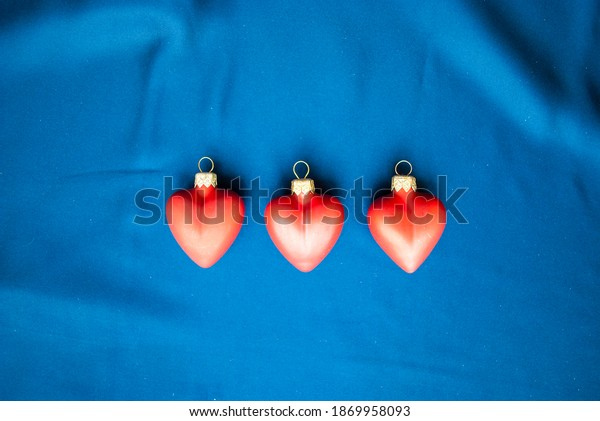 New Year decoration. Three red bright hearts. Christmas holidays concept