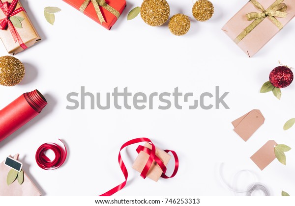 New Year decorations, gifts and ribbons on a white background top view