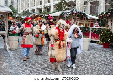 New Year. Dressed up buffoons walk through the decorated streets of Moscow. Christmas market on the festive red square. Russia, Moscow, January 2020.