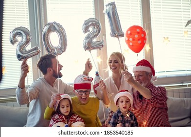 New Year eve family gathering at festive home party. New Year, holiday, family time together