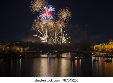 New Year Eve Firework in Prague, Czech Republic.  Big firework and reflection in river Vltava.