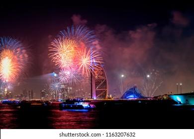 New year eve skyline fireworks. Iconic landmarks. Dubai, United Arab Emirates.
