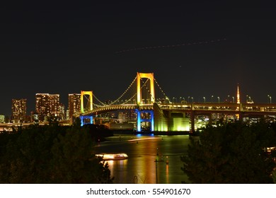 New Year Eve, Skyline with Rainbow bridge and  Tokyo tower at sunset in Odaiba, Tokyo Japan