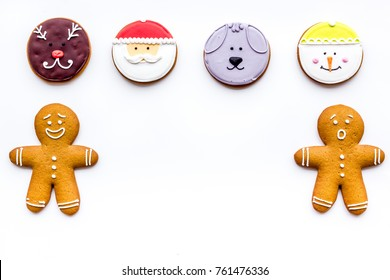 New Year Eve's recipes. Gingerbread cookies with confictionery glaze on white background top view copyspace
