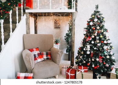 New Year festive interior. Christmas decorations. Holiday concept. Decorated Christmas tree with gifts. Decorated Christmas porch.