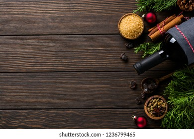 New Year food background. Ingredients for making Christmas mulled wine (bottle of red wine, orange, cane sugar and spices). Top view.