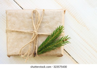 New year gift box handicraft wrapping, parchment twine fir tree twigs, cute simple last minute present handmade