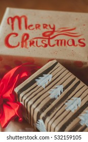 New year gifts boxes festive wrapping. Recycled paper with hand lettering decorations. New Year 2017 and Merry Christmas. Postcards and wrapping paper with handlettered calligraphy. hand lettering