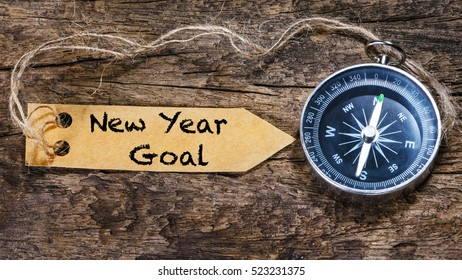 New year goals - motivation handwriting on label with compass
