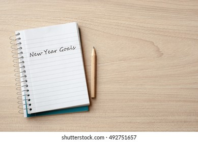 new year goals on notebook on desk