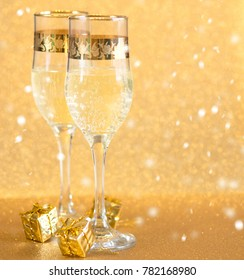 New Year golden champagne glasses background