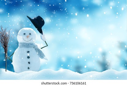New year greeting card with copy-space.Happy snowman standing in christmas landscape.Snow background