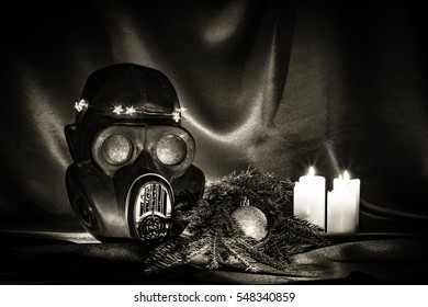 New Year greeting card in ex Soviet style. Ex Soviet gas mask. Legacy of USSR. Relic gas mask. New Year tree and candles. Intimate candlelight. Fetish and seduction.
