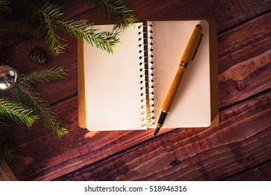New Year greeting card on wooden table with decorations and christmas tree
