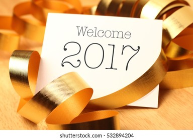 New year greetings with gold decorations. New Year's Day, also called simply New Year's or New Year, is observed on January 1.