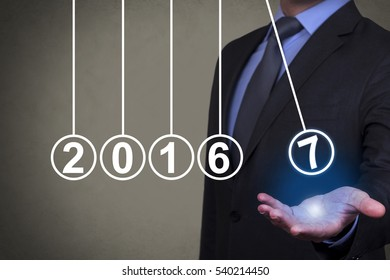 New Year Innovation Concepts over Business Person Hand