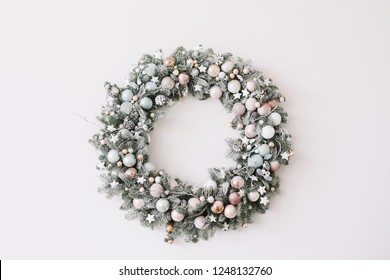 New Year interior.  Wreath of spruce  with garland. Christmas decorations. Holiday concept