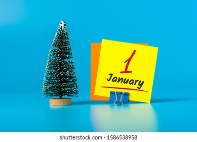 New year. January 1st. Day 1 of december month, calendar with little christmas tree on blue background. Winter time