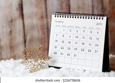 New Year - January 2019 calendar on the snow and Christmas ornament - star