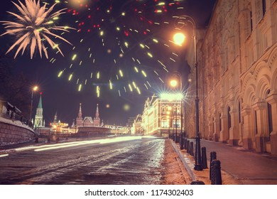 New Year in Moscow, Russia. Fireworks and glowing lights on city street decorated celebration. Christmas in Moscow. Red Square and GUM illuminated celebrate lights. fireworks over Kremlin