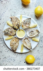New Year Oysters with lemons on white plate