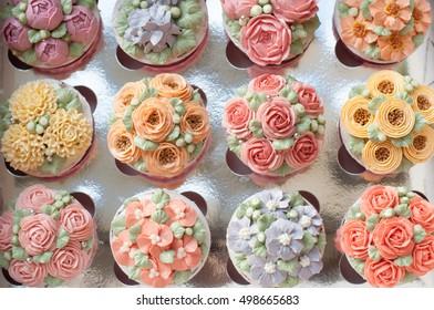 New year present concept buttercream flower cupcake.