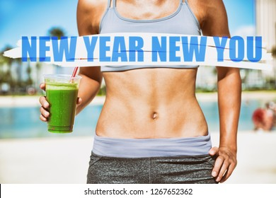 New Year resolution for 2019 : Getting in shape with fitness and diet. Fit woman with abs flat stomach eating drinking green smoothie.