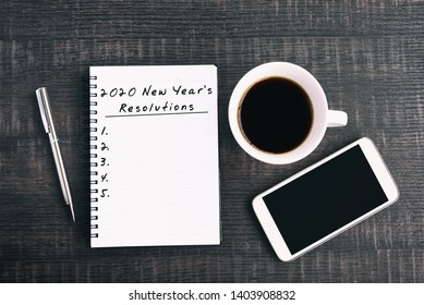 New Year Resolution Concept - 2020 New Year's Resolutions text on note pad