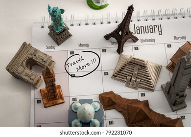 New year resolution and the desire to travel more concept with a calendar with january first circled and famous world landmarks