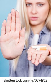 New Year resolutions, bad habits, unhealthy lifestyle concept. Woman holding broken cigarette, getting rid of addiction