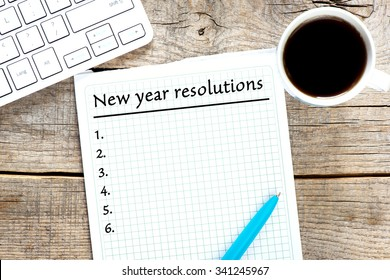New year resolutions written on paper