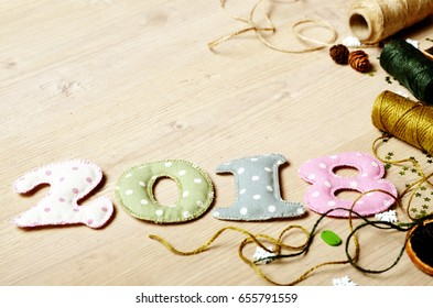 New year theme decoration figures of 2018 with threads and ropes