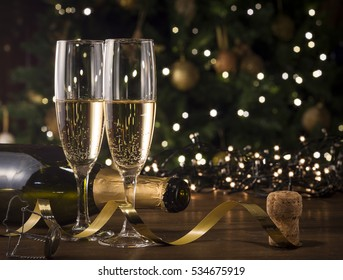 New Year Toast champagne , Christmas tree background