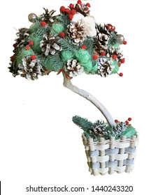 New Year Topiary in a wicker flowerpot. Topiary cap is made of cones, red berries, Christmas tree branches