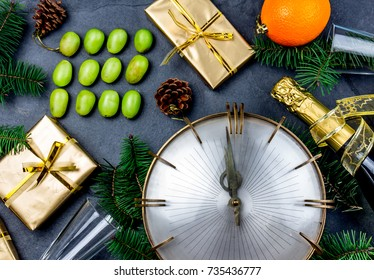 NEW YEAR TRADITION. Latin American and Spanish New Year traditional. Funny ritual to eat twelve 12 grapes for good luck at midnigth. Flat lay, top view. Christmas New Year composition