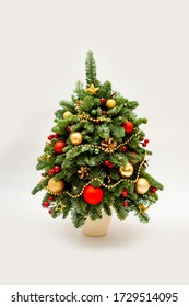 New Year tree made of fir decorated with flowers from cloth and balls