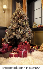 New year and xmas room interior concept. Christmas tree with present boxes in living room. Festive decorations and ornaments. Time to celebrate winter holidays.