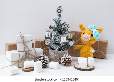 New Year Yellow pig 2019. Marshmallows. New Year's and Christmas. Christmas tree and gifts of jewelry, bracelets with charms. Huggy concept.
