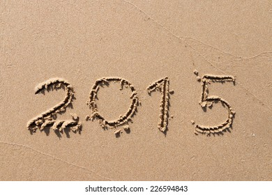 New years 2015 write on sand at the beach