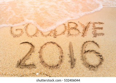 New Years 2017 is coming concept, Goodbye 2016 on the sand beach