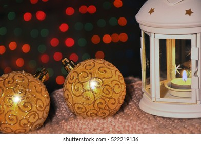 New Year's background. lamp with a candle and Christmas balls