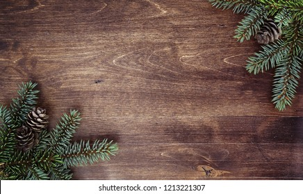 New Year's background. Spruce branches on a wooden table. Ornaments for the New Year tree. Christmas concept