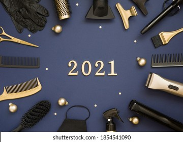 New year's banner with hairdressing tools, Christmas balls and numbers 2021. Gold and black hair salon accessories on a blue background.