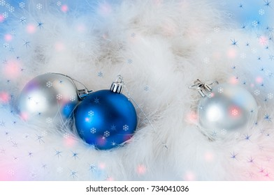New Year's blue and silver balls on white fluff