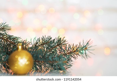 New Year's card live tree with decorations garland on a background of colorful lights bokeh gentle photo place for inscription